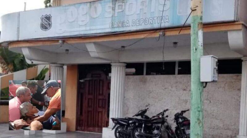 Hieren mujer de bala en medio de asalto a banca deportiva en La Romana; asaltantes cargan con 1 millón 983 mil pesos